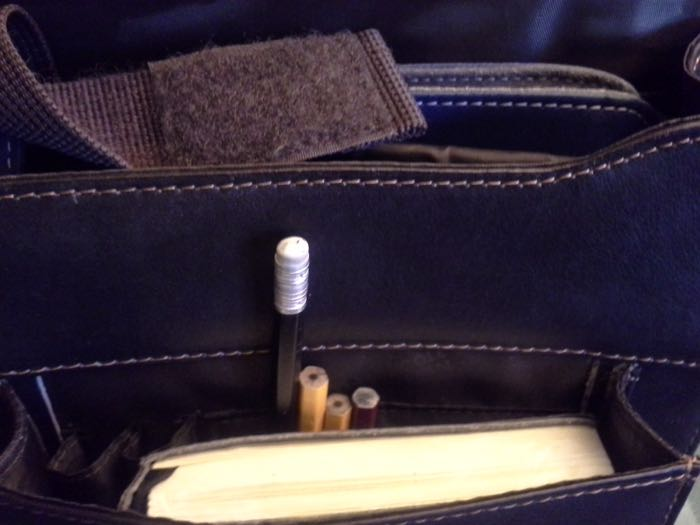Roach will not purchase a computer bag unless it has a suitable compartment for his miniature pencils.